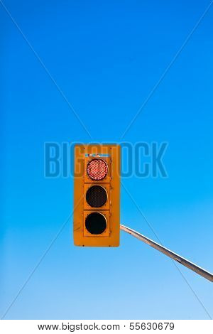 Red Traffic Light Against Blue Sky With Copyspace