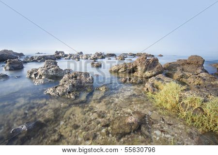 Sea And Rocky Coast In The Morning