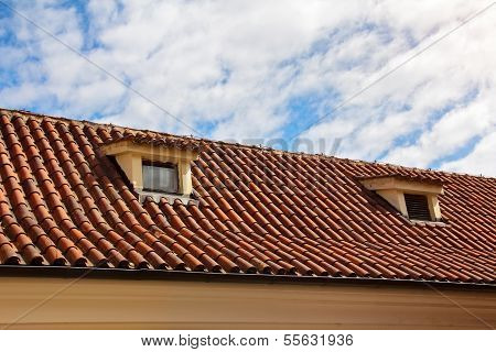 Red Tiled Roof With Garret Windows