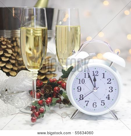 Happy New Year Table Setting With White Retro Clock Showing Five To Midnight With Champagne And Fest