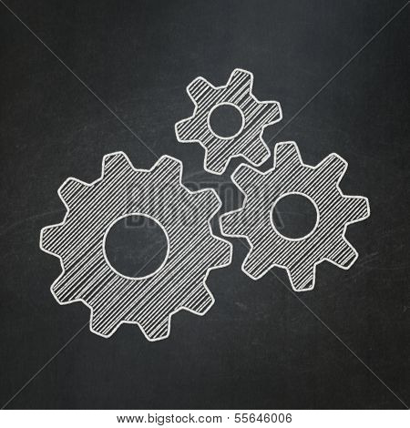 Business concept: Gears on chalkboard background