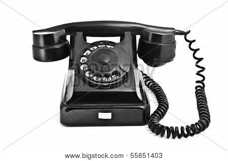 An Old Black Vintage Rotary Style Telephone
