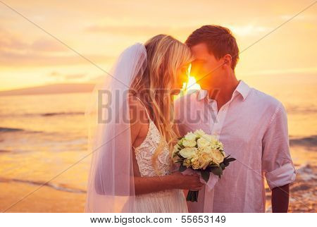 Bride and Groom, Enjoying Amazing Sunset on a Beautiful Tropical Beach, Romantic Married Couple Kissing
