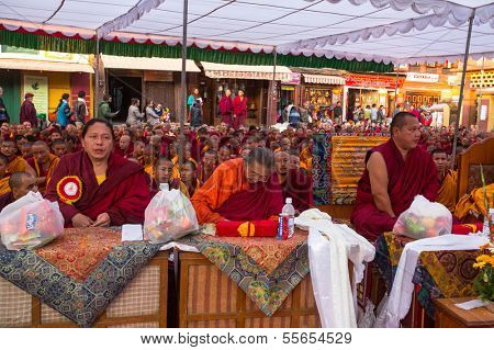 KHATMANDU, NEPAL - DEC 15: Unidentified tibetan Buddhist monks near stupa Boudhanath during festive Puja of H.H. Drubwang Padma Norbu Rinpoche's reincarnation's, Dec 15, 2013 in Khatmandu, Nepal.