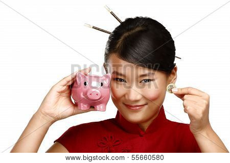 Traditional Asian Woman Save A Coin In A Piggybank