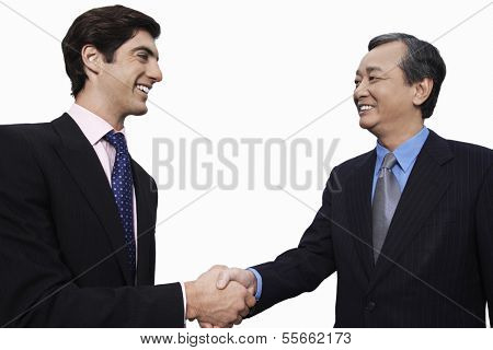 Happy businessmen shaking hands over white background