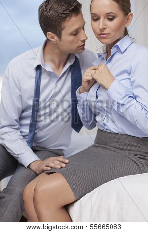 Passionate business couple in hotel room