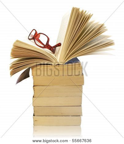 Stack Of Books With Eyeglasses Isolated On White