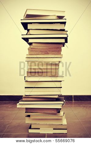 picture of a pile of books on the floor with a retro effect