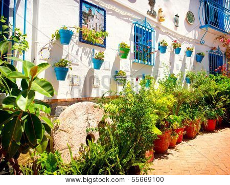 Torremolinos. Costa del Sol, Andalucia. Typical White Village with flower pots in facades at Spain