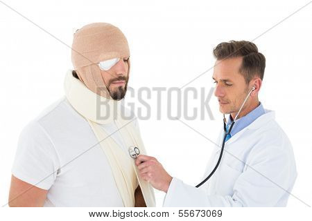 Side view of a doctor auscultating a patient tied up in bandage with stethoscope over  white background