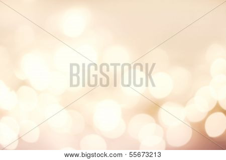 Abstract Defocused Bokeh Lights As Festive Background Or Texture. Golden Blur Lights Over Backdrop.