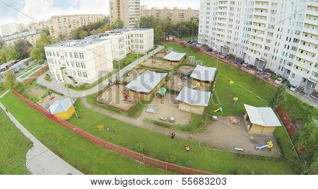 Kindergarten with playground near residential complex. View from unmanned quadrocopter.