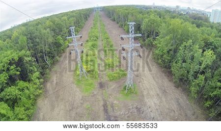 Power lines among forest. View from unmanned quadrocopter.