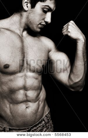 Sexy Man With Muscular Biceps And Abs