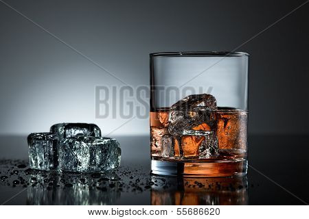 Whiskey Glass With Wet Ice Cubes