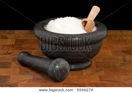 Mortar and pestle with salt