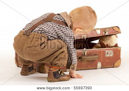 Little Boy Is Packing His Suitcase