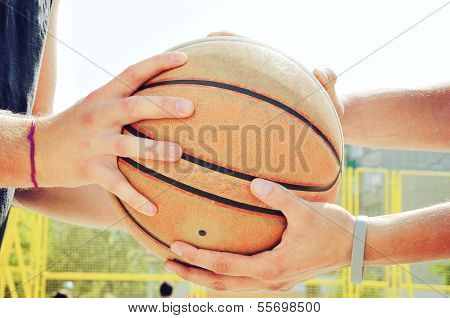 Basketball Players Holding The Ball. Fairplay Concept.