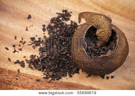 Pu-erh. Chinese Tea Packed In Dried Mandarin On Wooden Table