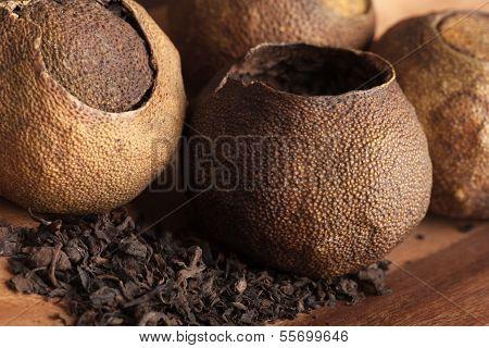 Pu-erh. Chinese Dark Tea Packed In Dried Mandarins