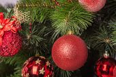 stock photo of boll  - Christmas decoration with shiny glare  a red boll - JPG