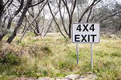 picture of four-wheel drive  - four wheel driving sign points to the exit track in the bush