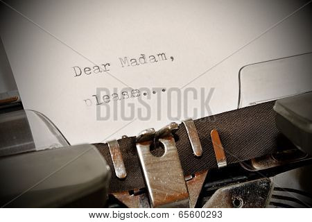 Text Dear Madam Typed On Old Typewriter