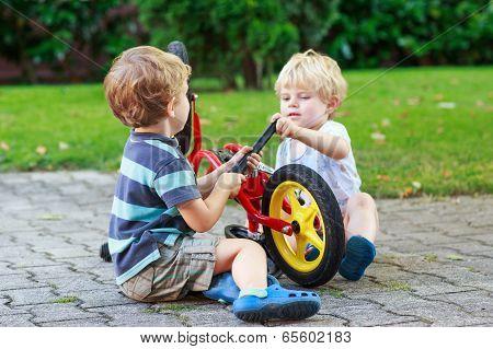 Funny Little Sibling  Boys Repairing Bicycle Wheel