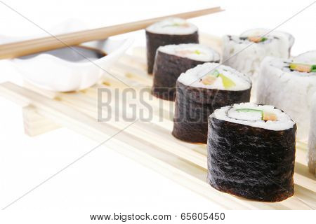 California Roll with Avocado and Salmon, Cream Cheese and Raw Salmon inside. on wooden grid . isolated over white background . Maki Sushi and Sashimi