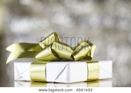 White Present With Gold Ribbons