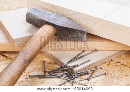 Mallet With Nails And Planks Of New Wood