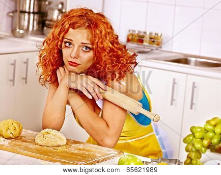 Young woman  baking cookies in oven. Bad luck.