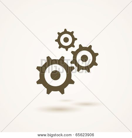 Set of three gears or cogs in different sizes
