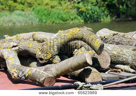 Logs on top of narrowboat.
