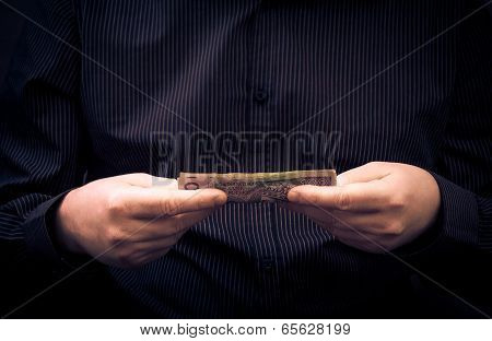 Man Holds Hands Polish Money
