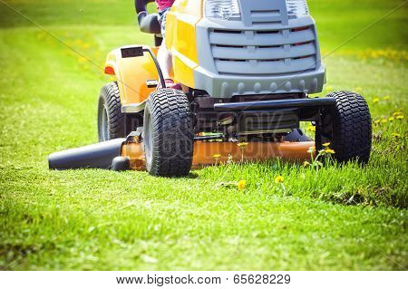 Closeup of mower cutting the grass