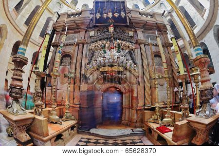 JERUSALEM, ISRAEL - MARCH 9, 2012: Church of the Holy Sepulcher in Jerusalem. Beautifully decorated with pink marble interior entrance to Edicule