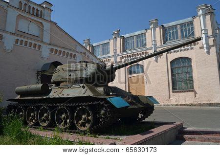 KIEV, UKRAINE - MAY 26, 2014: The monument of soviet tank T-34 near technical laboratories of National Polytechnic University on May 26, 2014 in Kiev, Ukraine