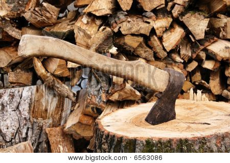 Ax stuck in a large timber