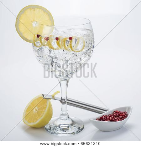 Gin And Tonic With Pink Pepper And Lemon Twist
