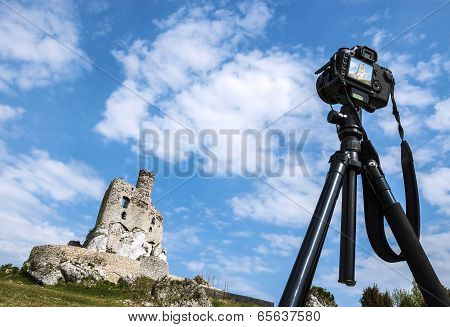 Making Postcard, Camera On Tripod Takes Pictures Of Summer Landscape With Castle.