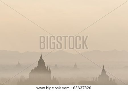 Sunrise Colors And Silhouettes Of Ancient Sulamani And Tha Beik Hmauk Gu Hpaya. Myanmar (Burma)