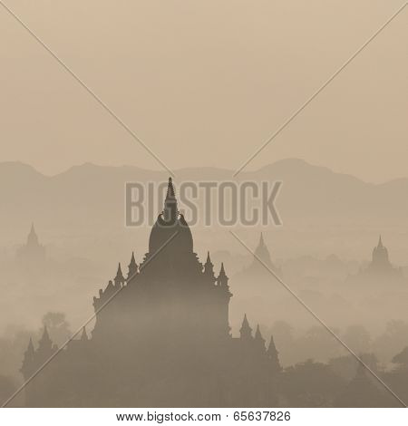 Sunrise Colors And Silhouettes Of Ancient Sulamani And Tha Beik Hmauk Gu Hpaya. Myanmar (Burma)
