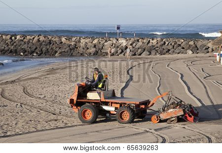 Special Machine Sifts The Sand On The Beach