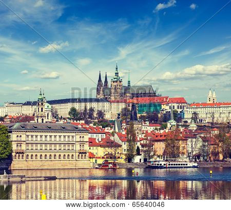 Vintage retro hipster style travel image of Charles bridge over Vltava river and Gradchany (Prague Castle) and St. Vitus Cathedral