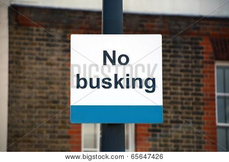 No Busking Sign