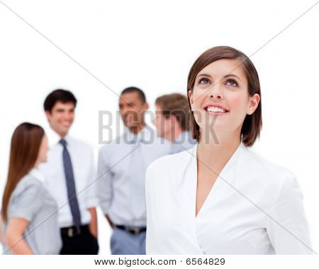 Young Businesswoman Looking Up In Front Of Her Colleagues