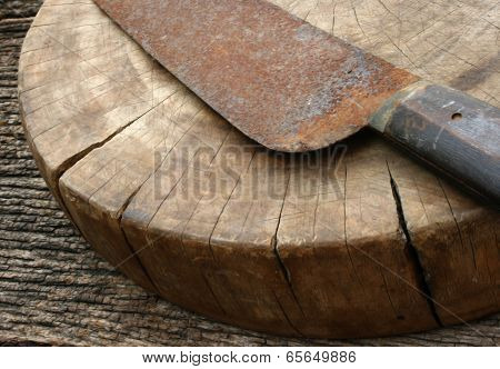 Wood Cutting Board And Rusty Knife