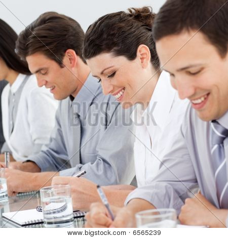 Young Business People Taking Notes At A Conference